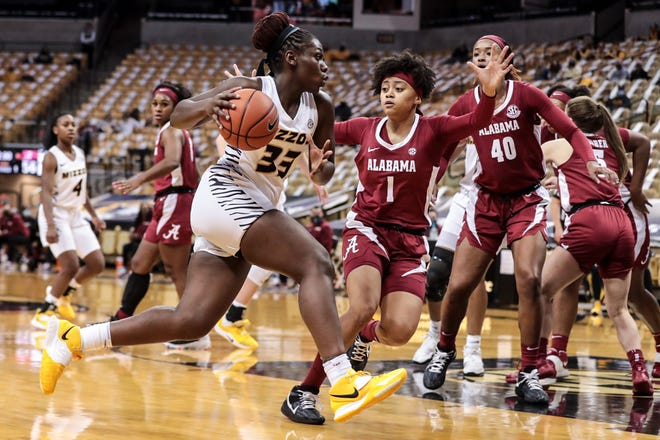 Missouri guard Aijha Blackwell (33) dribbles the ball during a game against Alabama on Thursday at Mizzou Arena.