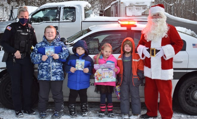 The Penn Yan Police Department was contacted about helping families in the area around Christmas time.  The Police Benevolent Association came together and bought several presents to pass out.  The PBA also enlisted the help of Santa Claus, who came to Penn Yan and made a few special stops.