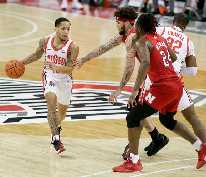 Ohio State Buckeyes guard CJ Walker (13) is guarded by Nebraska Cornhuskers guard Teddy Allen (0) and Nebraska Cornhuskers forward Yvan Ouedraogo (24) during the first half of Wednesday's NCAA Division I basketball game at Value City Arena in Columbus, Oh. on December 30, 2020.