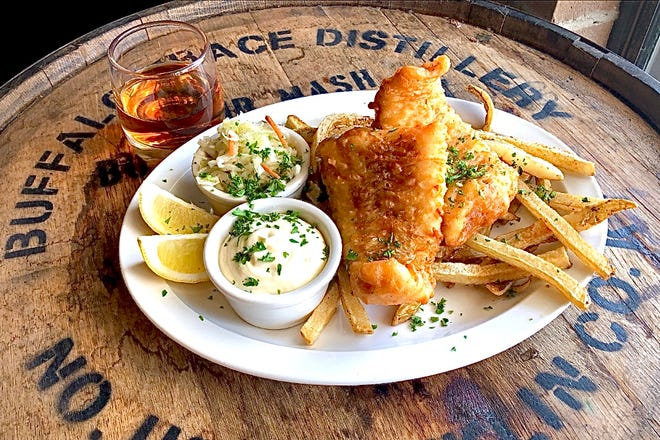 The fish and chips comes with vinegar slaw, tarter sauce and choice of a side