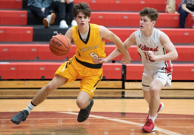Zach Geiser blows by a defender during Waynedale's win over Hiland earlier this year. Geiser is averaging 17.2 points per game for the 6-2 Golden Bears.