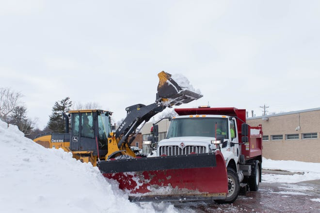 Adel city crews move snow around the courthouse square on Wednesday, Dec. 30.