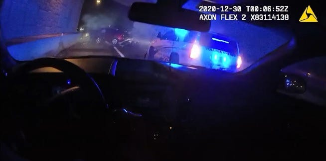 A still photo from a Volusia County deputy's body camera shows the deputy arriving at the scene of the fatal crash Tuesday night on Interstate 95 near Daytona Beach.