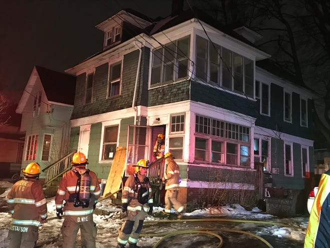 Erie fire crews extinguished a first-floor fire Wednesday night inside this vacant house at 614/616 Wallace St.