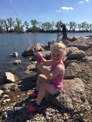 Take the opportunity to introduce young children to possibly a lifetime of fishing.