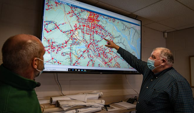 Deputy Community Services Director Bill Boulanger, right, reviews geographic information system data about a significant water leak discovered on Christmas Day, Dec. 25, 2020, with Community Services Director John Storer.