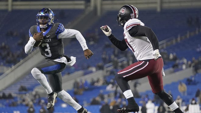 Kentucky's run-oriented offense is triggered by quarterback Terry Wilson, who has 1,505 yards in total offense in nine games.