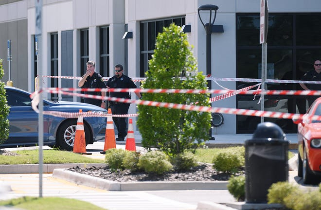 Jacksonville sheriff's detectives work the scene of one of the city's 175 homicides in 2020. This was June 29 outside the Amazon warehouse on Pecan Park Road where a man was ambushed waiting in line for a job with other applicants.