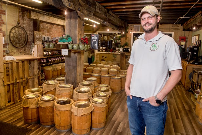 James Cross, owner of Leaves 'n Beans, poses in the company's store and roastery at 4416 N. Prospect Road in Peoria Heights. The popular coffee business is expanding to a new store at 3208 Court St. in Pekin. In addition to the roastery, Leaves 'n Beans operates shops in Peoria Heights and Morton.