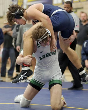 Twinsburg's Aidan Corrigan, top, battles Aurora 170 pounder Ethan Anderson in the Suburban League Wrestling Tournament last January. Corrigan returns as a state qualifier this winter.