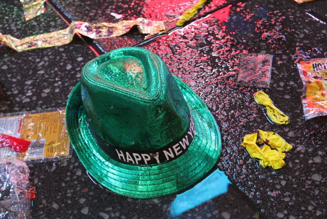 "In this Jan. 1, 2019, file photo a ""Happy New Year"" hat lies on the wet ground along with other items following the celebration in New York's Times Square. Setting a New Year's resolution about improving your finances is an excellent way to start 2021. But before you come up with a list of goals, be aware that there are a few you should avoid."