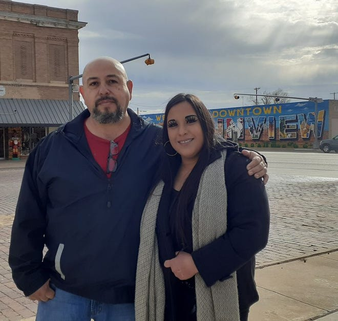 Artist Alfonso Garcia thanked his daughter Tiffanny Renae Garcia for helping him complete a months-long project to create a mural in downtown Plainview.