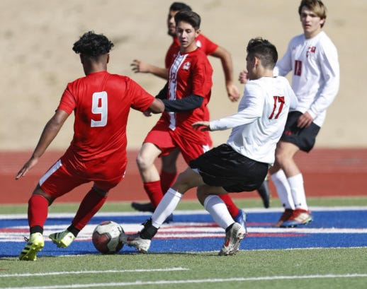 Lubbock-Cooper's Christian Hernandez (17) kicks the ball past Jefferson's Bradley Barraza (9) during a match in the Teinert Construction Kick-off Classic on Friday, Jan. 10, 2020 at PlainsCapital Park at Lowrey Field in Lubbock, Texas.
