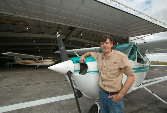 Cole Harris, owner and president of Central Florida Aircraft Services, stands next to a Cessna 172 at his aircraft maintenance facility at Lakeland Linder International Airport last week. Harris is the first graduate of Central Florida Aerospace Academy, located on the south side of Lakeland Linder International Airport, to open a business at the airport.