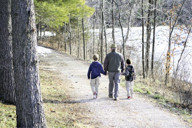 Mike Jeffries explores the grounds around the Central Office with his grandsons.