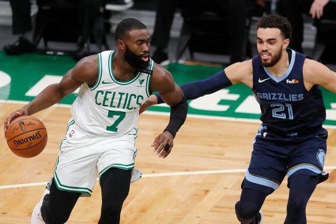 Celtics guard Jaylen Brown (left) drives past Grizzlies' Tyus Jones during the first half of Boston's 126-107 blowout win over Memphis. Brown scored a career high 42 points.