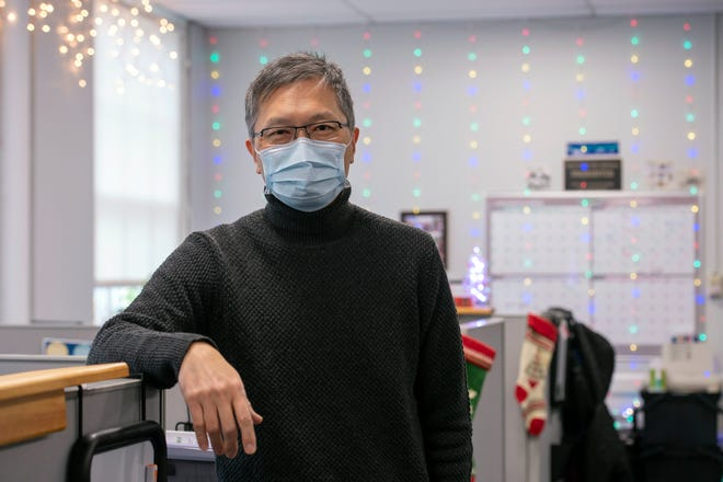 Framingham Director of Public Health Sam Wong on his last day Thursday, Dec. 31, 2020, in the Health Department offices inside the Memorial Building.