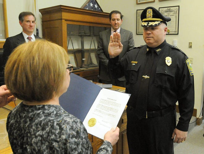 Edward Lee is sworn in as Hopkinton's police chief in 2014, where he served for six years before resigning.