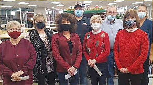 Pratt Public Library's 2020 Read for Charity event was a success, raising $1,765.53 for the Pratt County Angel Tree Program. Pictured, left to right, are Hollis Myers, Main Street Dental; Debbie Polok, Southwest Truck Parts; Kerry Von Schriltz, The Peoples Bank; Kyle Polok, Southwest Truck Parts; Cindy Keller, Stanion Wholesale Electric; Dale Withers, Southwest Truck Parts; Chris Himmelwright, Pratt Library Board; and Tammy Killough, Pratt Teen Center.