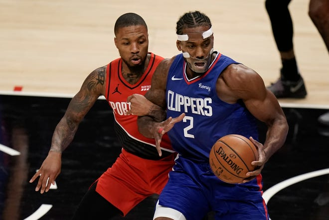 Los Angeles' Kawhi Leonard (2), who had 28 points, tries to get past Portland's Damian Lillard during the second quarter of Wednesday's game. The Clippers won 128-105.