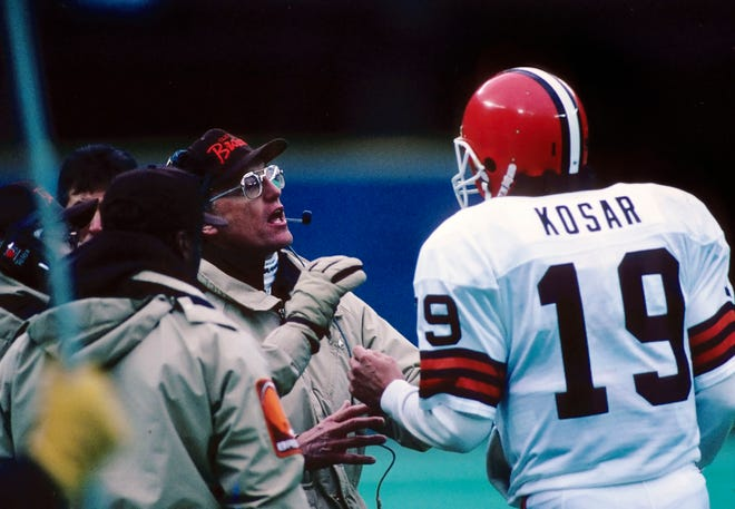 Browns head coach Marty Schottenheimer on the sideline with Bernie Kosar (19) against the Steelers at Three Rivers Stadium in Pittsburgh, Dec. 26, 1987. The Browns defeated the Steelers 19-13. (USA TODAY Sports)