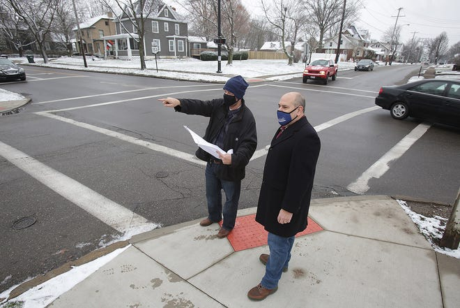 Dan Millsap (left), Louisville city service director, and Vince Marion, director of planning and development, talk about plans to widen E. Main Street (Route 153) and Nickel Plate Avenue.