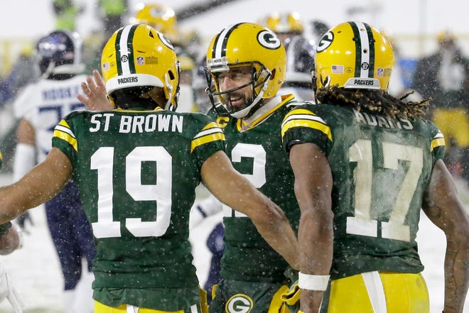 Green Bay Packers wide receiver Equanimeous St. Brown celebrates his touchdown catch with Aaron Rodgers (12) and Davante Adams (17) during the first half against the Tennessee Titans  on Dec. 27 in Green Bay, Wis.