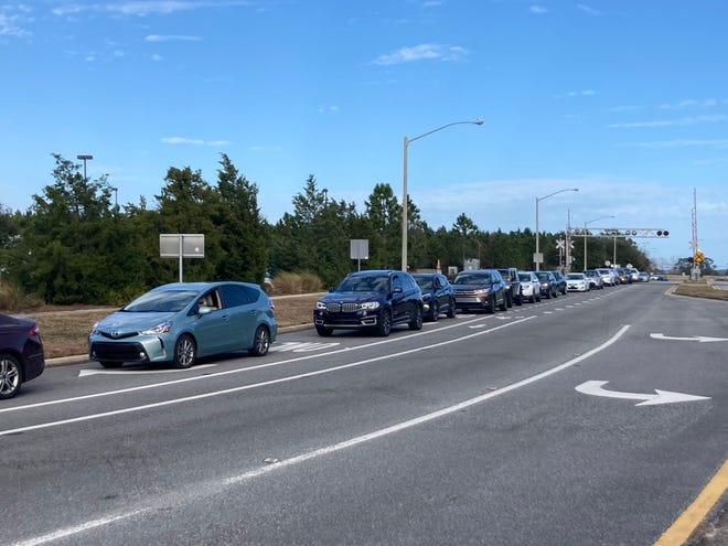 Vehicles line up near the St. Johns County health department to receive a COVID-19 vaccine on Thursday.