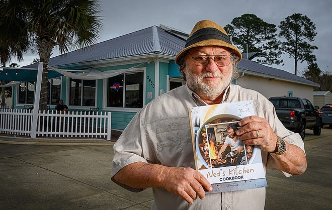Ned Pollack holds a copy of his cookbook outside of Ned's Southside Kitchen in St. Augustine on Wednesday, Dec. 30, 2020.