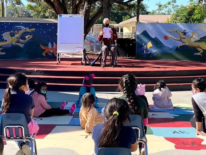 Sarasota illustrator Frank Remkiewicz talks to children at the RCMA school in Immokalee.