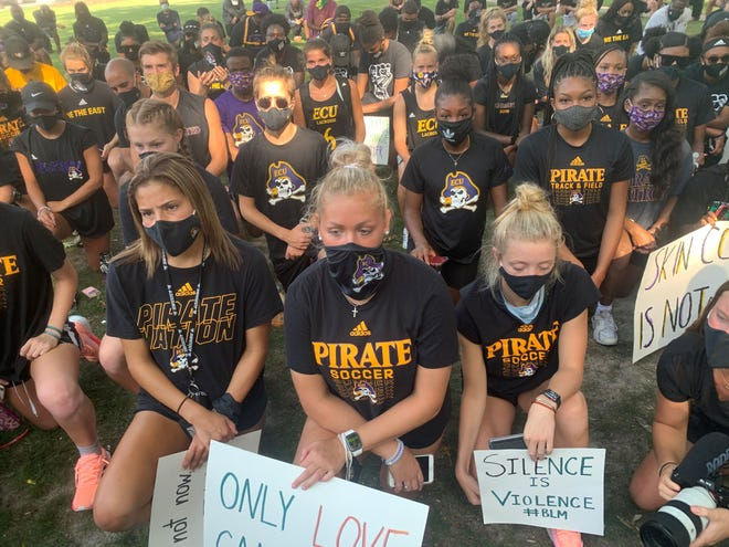 Led by students, ECU athletic programs joined together in a march from Dowdy-Ficklen Stadium to the Cupola to take a stand in the fight for equality on Aug. 31.