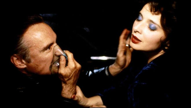 "Dennis Hopper (left) and Isabelle Rossellini star in David Lynch's ""Blue Velvet,"" which shot in Wilmington and was Oscar nominated."