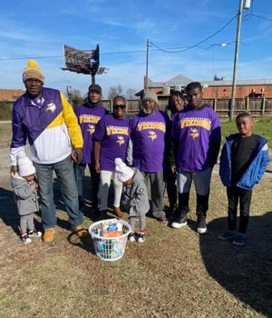 New Bern native and Minnesota Vikings cornerback Mike Hughes recently donated to nearly 100 families in the James City Community. The families received toiletries, such as paper towels, toilet tissue, hand sanitizer, wipes and more. Pictured, from left are community members who assisted with delivering the donation, adults are Hughes' father Marcus Jones, Miles Lee, Evelyn Forbes, William Stevens, Michelle Forbes, Juwan Wallace. [CONTRIBUTED PHOTO]