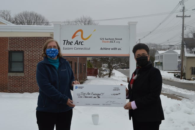 Nancy Bulkeley, pictured left, senior community affairs representative for Dominion Energy, presents the Dominion Foundation's grant award check to The Arc ECT's CEO Kathleen Stauffer.