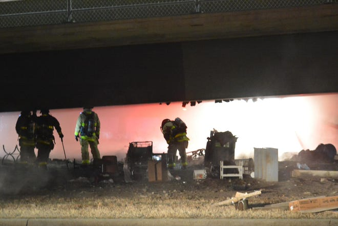 Homeless camp under Kansas Avenue Bridge destroyed by fire.