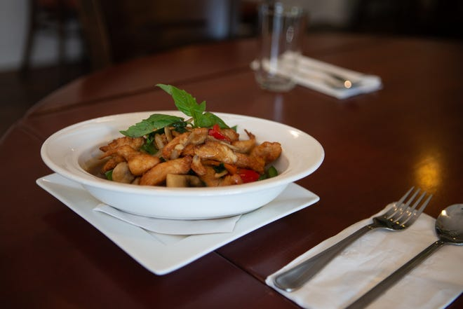 A plate of Melissa's Chicken, with stir-fried chicken breast marinated in a house seasoning with a touch of white rum, bell pepper, mushrooms, onion and basil in a brown sauce, is one of many unique dishes offered at Jong's Thai Kitchen, 800 S.W. 12th St. [Evert Nelson/The Capital-Journal]