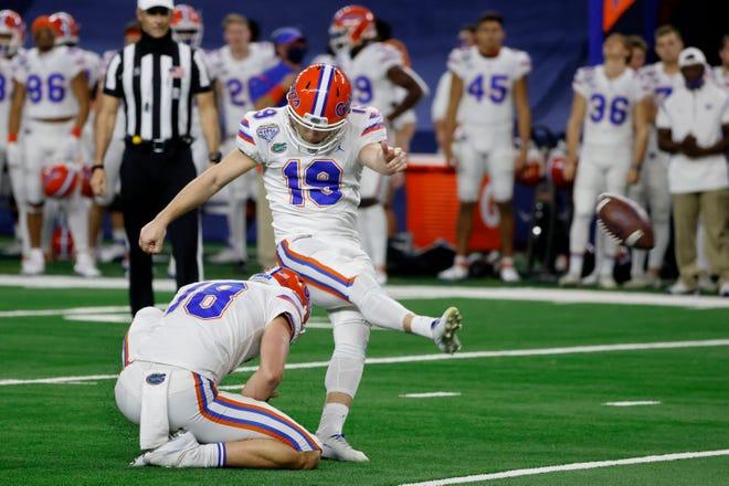 Florida punter Jacob Finn (18) holds as Evan McPherson (19) kicks a field goal against Oklahoma during the first half of the Cotton Bowl in Arlington, Texas, on Dec. 30, 2020.