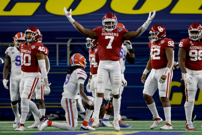 Oklahoma defensive end Ronnie Perkins (7) celebrates after sacking Florida quarterback Emory Jones during the second half of the Cotton Bowl in Arlington, Texas, on Wednesday.
