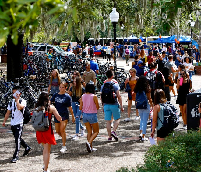 Students walk through Turlington Plaza on the first day of classes at the University of Florida in August 2019.