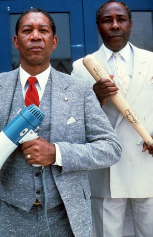 "The movie ""Lean on Me,"" starring actor Morgan Freeman, left, captured educator (right) Joe Clark's unorthodox leadership style."