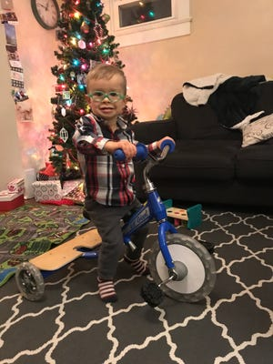 Jaxon Britton is all smiles on his new tricycle.