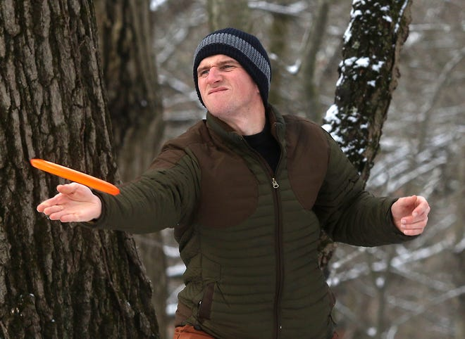 Jono Stephens of Strasburg takes a shot during a round of disc golf Thursday at the Dover City Park.