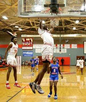 In a AHSAA sub-regional game against Chilton County on Feb. 11, 2020, Central's Taveon Goode dunks the ball.