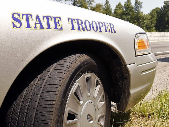 An Alabama state trooper vehicle is parked on Interstate 20/59 in Tuscaloosa County. [Staff file photo]