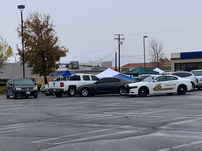San Bernardino County Sheriff's Department personnel investigate the scene of a deputy-involved shooting on Monday, Dec. 28, 2020, that left a 33-year-old Barstow man dead.