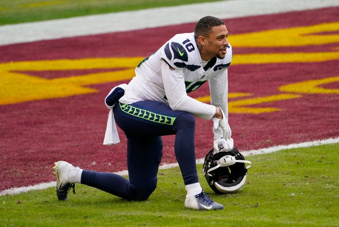 Seattle Seahawks wide receiver Freddie Swain (18) on the field before the start of an NFL football game against the Washington Football Team, Sunday, Dec. 20, 2020, in Landover, Md.