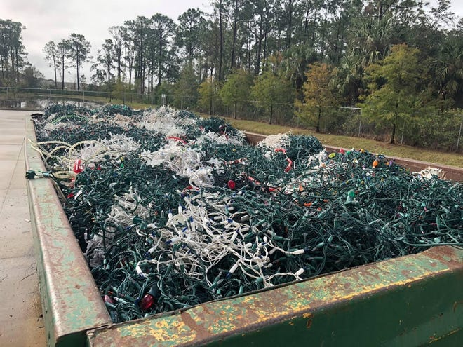 Improperly disposed-of Christmas lights fill a large dumpster at the Waste Management Recycling Brevard plant in Cocoa in this file photo.