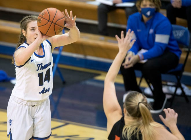 Thomas More Saints guard Zoie Barth (14), a Highlands graduate, was named the Outstanding Player of the Mid-South Championship.  She averages 13.2 points per game.