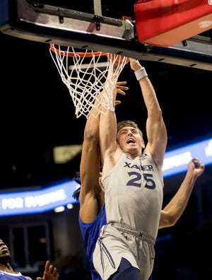 Xavier Musketeers forward Jason Carter (25) is fouled by Seton Hall Pirates center Ike Obiagu (21) in the first half of the NCAA men's basketball game between the Xavier Musketeers and the Seton Hall Pirates on Wednesday, Dec. 30, 2020 at Xavier University in Cincinnati.