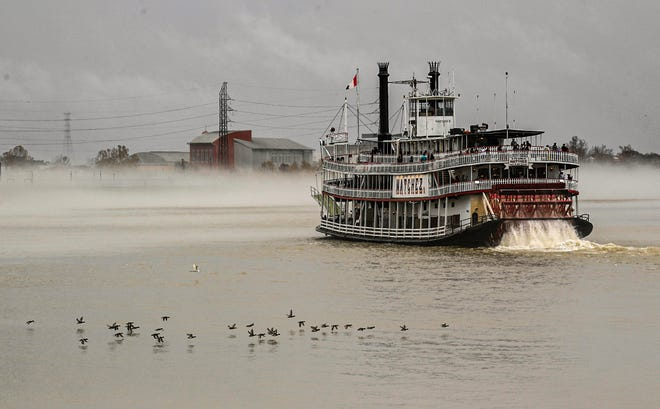 The Riverboat Natchez cruises the Mississippi River near the French Quarter in New Orleans on Dec 31, 2020.